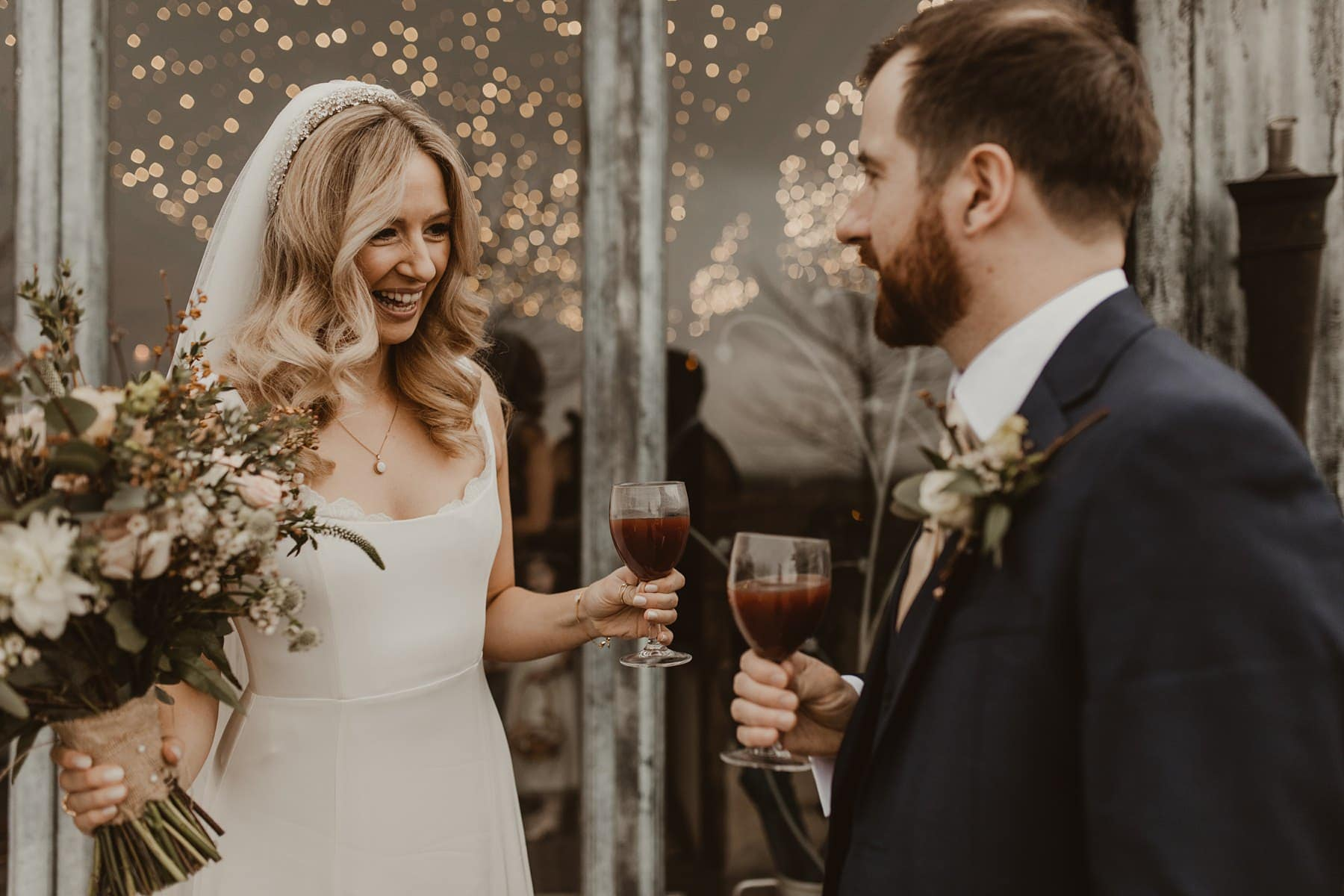 Bride and groom celebrating with mulled wine