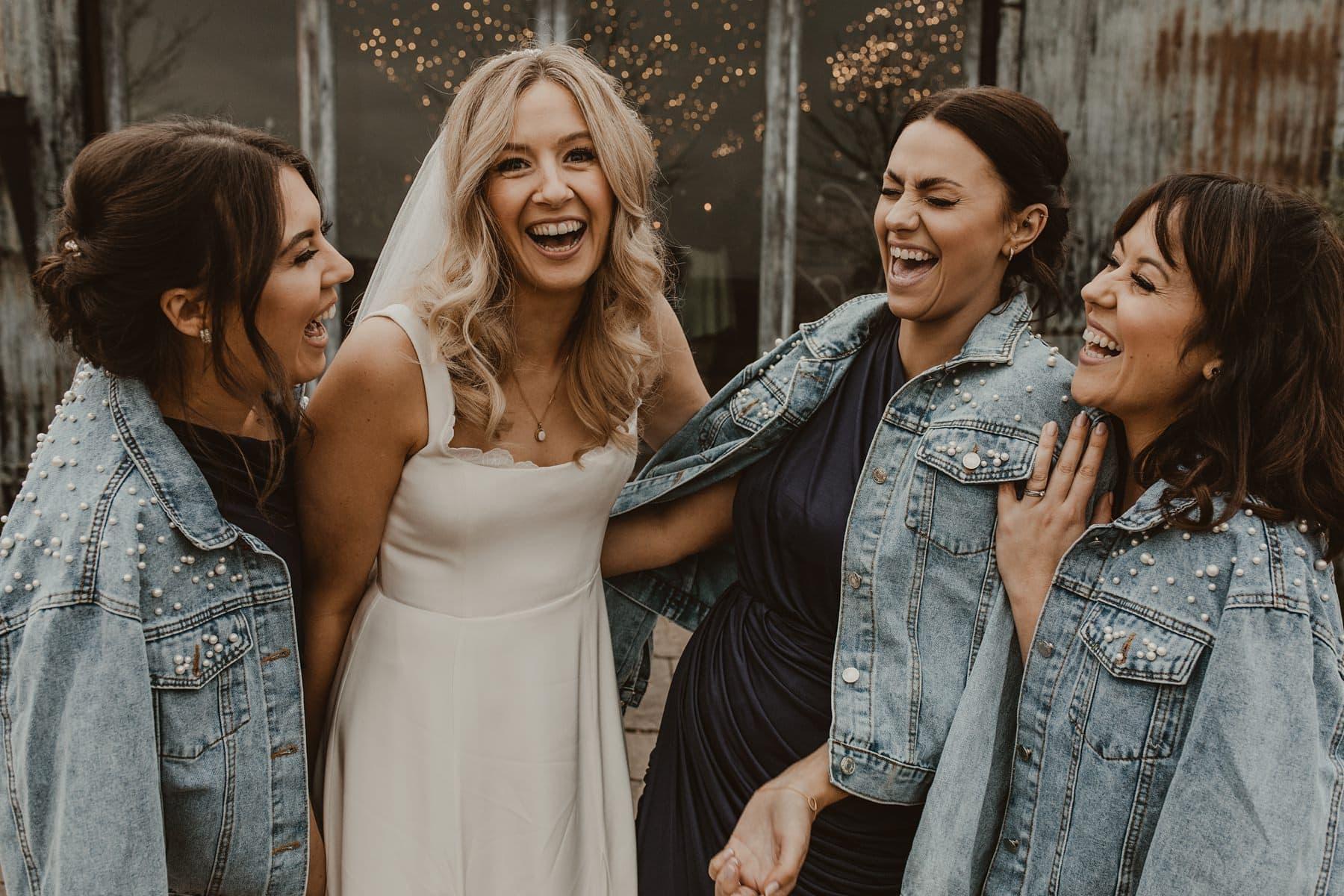 Bride and bridesmaids wearing denim jackets