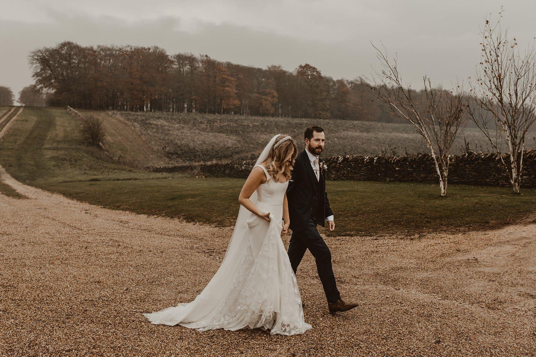 Couple walking through countryside at Stone Barn