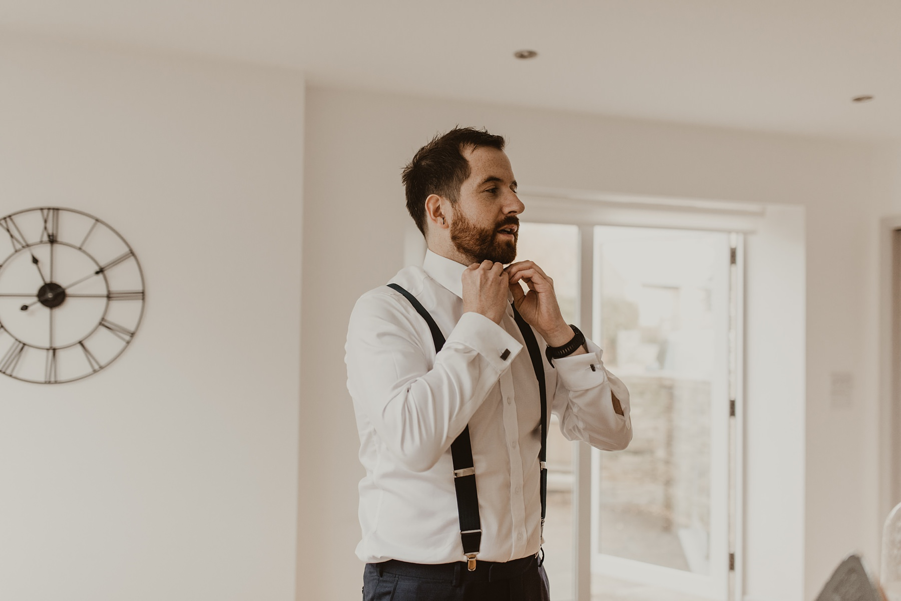 Groom doing up top button