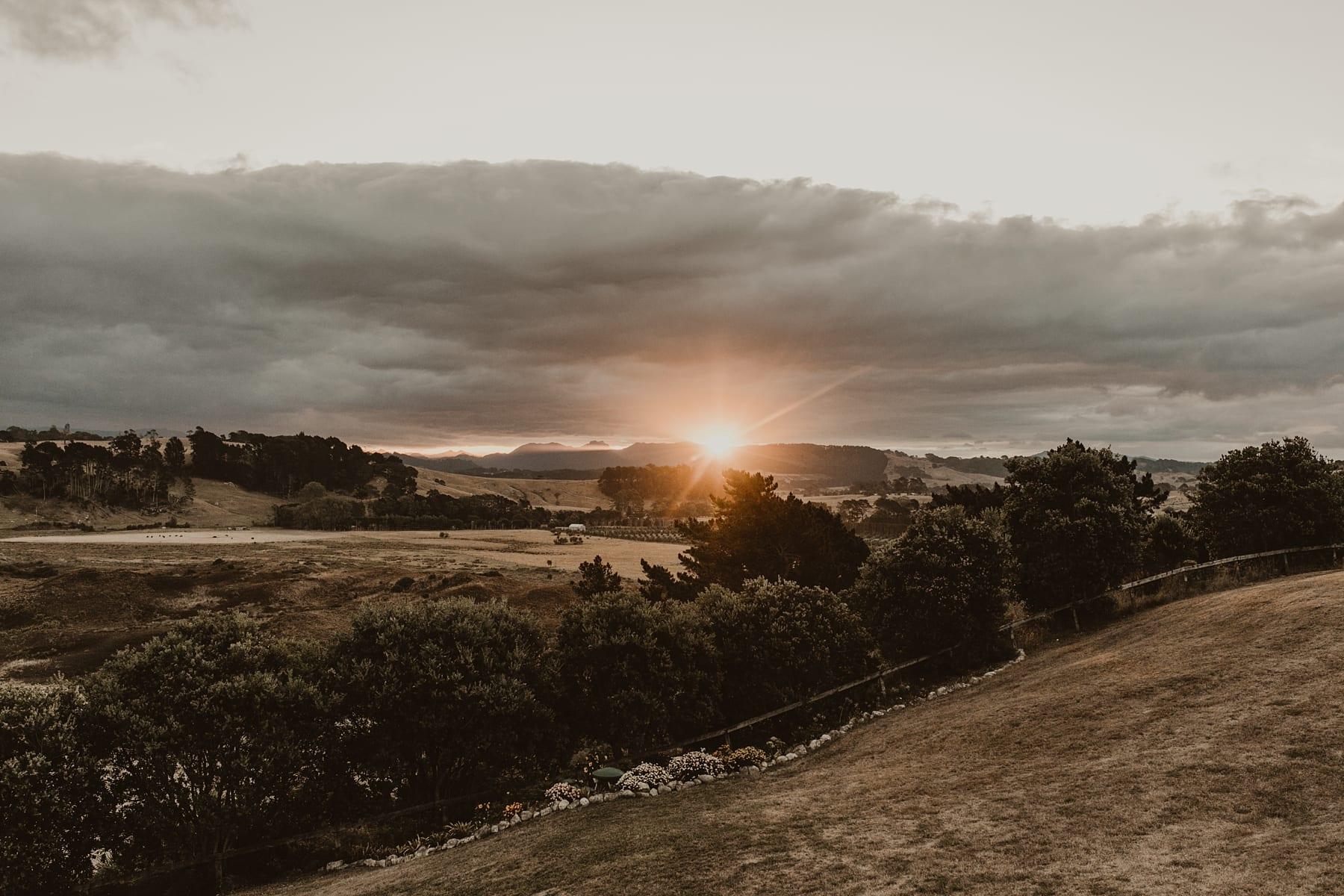 sun setting over landscape