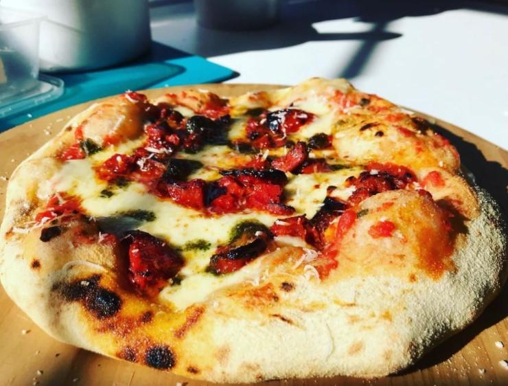 Chorizo and pesto pizza
