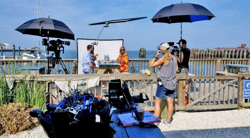 Eva filming an episode of HGTV Beachfront Bargain Hunt.