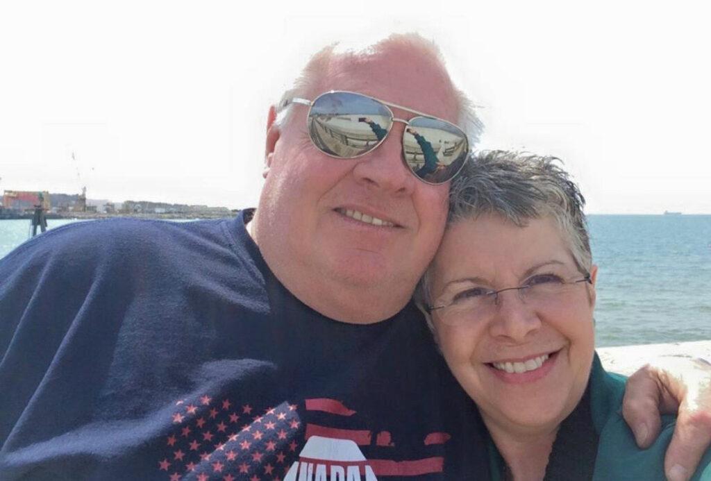 Kathy and her husband, Skip, taking a walk on the Cape Charles beach.
