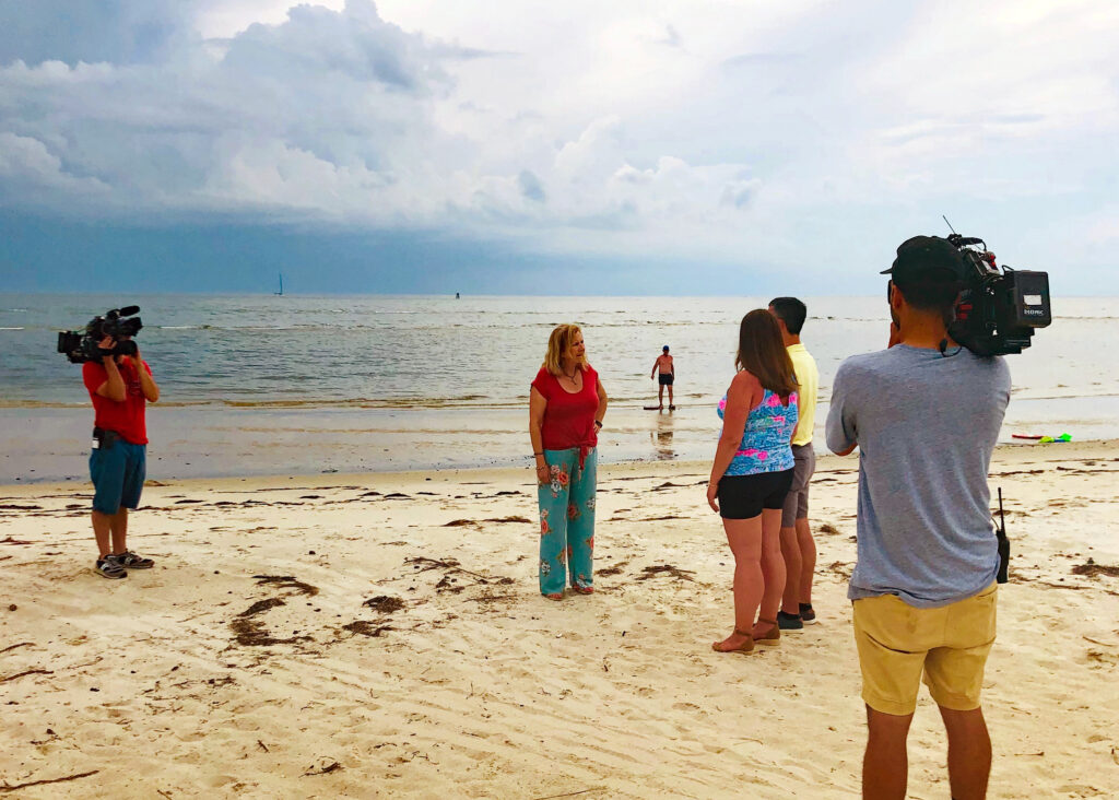Luisa filming an episode of HGTV Beachfront Bargain Hunt.