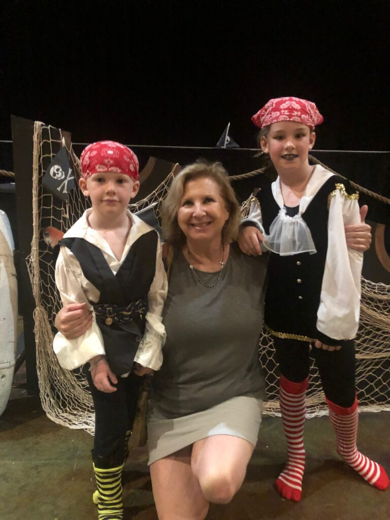 Luisa and her grandkids at Arts Enter Cape Charles, a performing arts organization.
