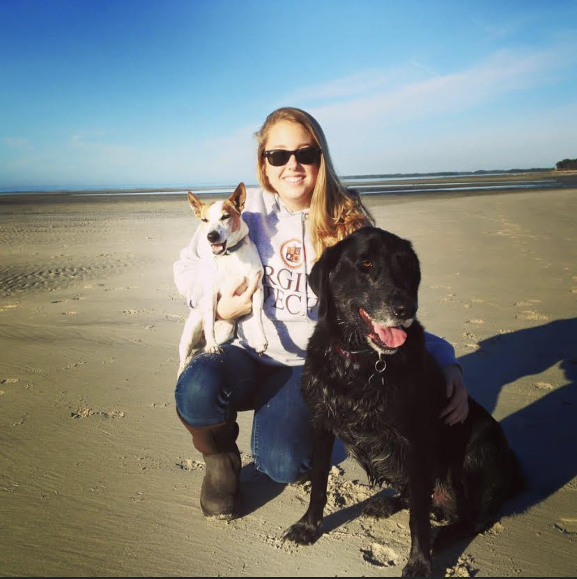 Laura and her two dogs on the beach