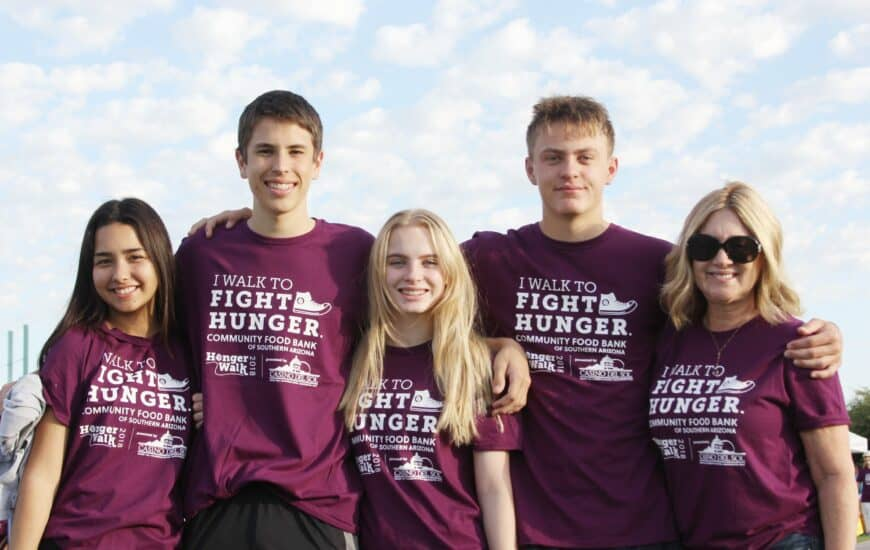 teenagers in hunger walk t-shirts
