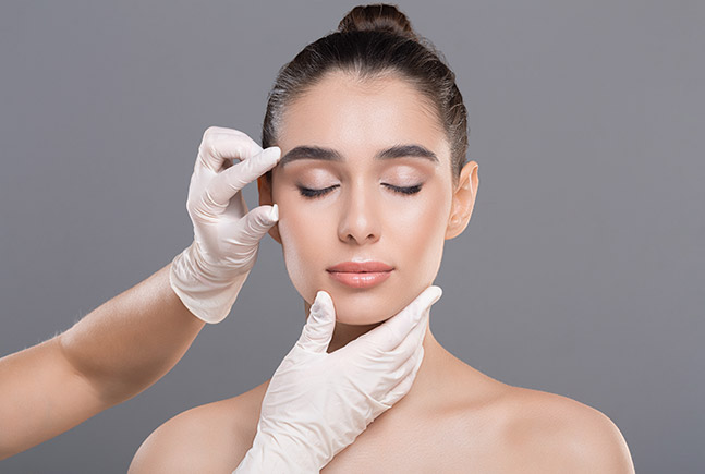 woman getting face examined Bellava MedAesthetics and Plastic Surgery Center in Bedford Hills, NY