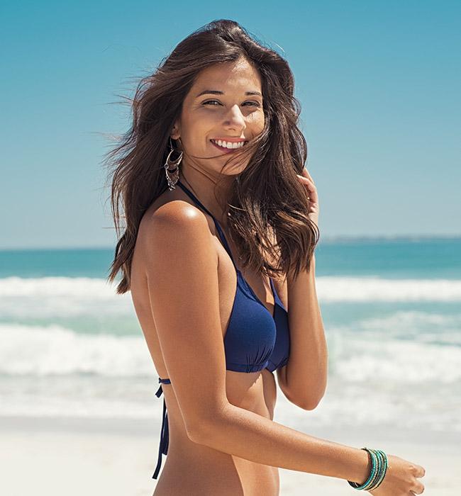 woman in bikini Bellava MedAesthetics and Plastic Surgery Center in Bedford Hills, NY