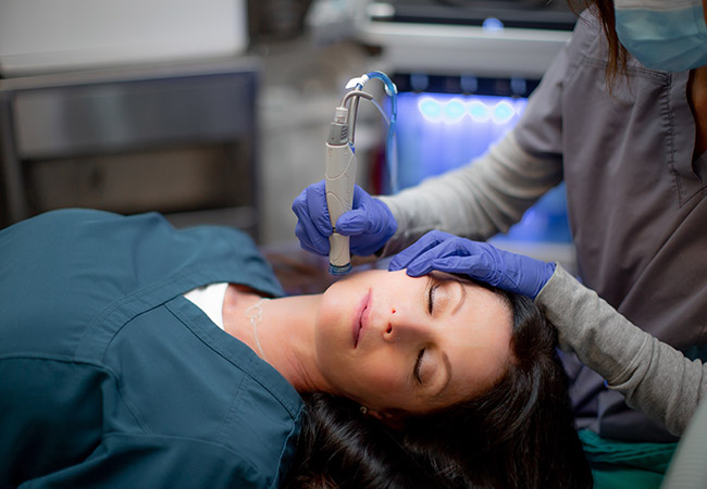 woman getting a facial by Bellava staff Bellava MedAesthetics and Plastic Surgery Center in Bedford Hills, NY