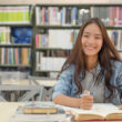 female-students-are-searching-research-papers_40919-909