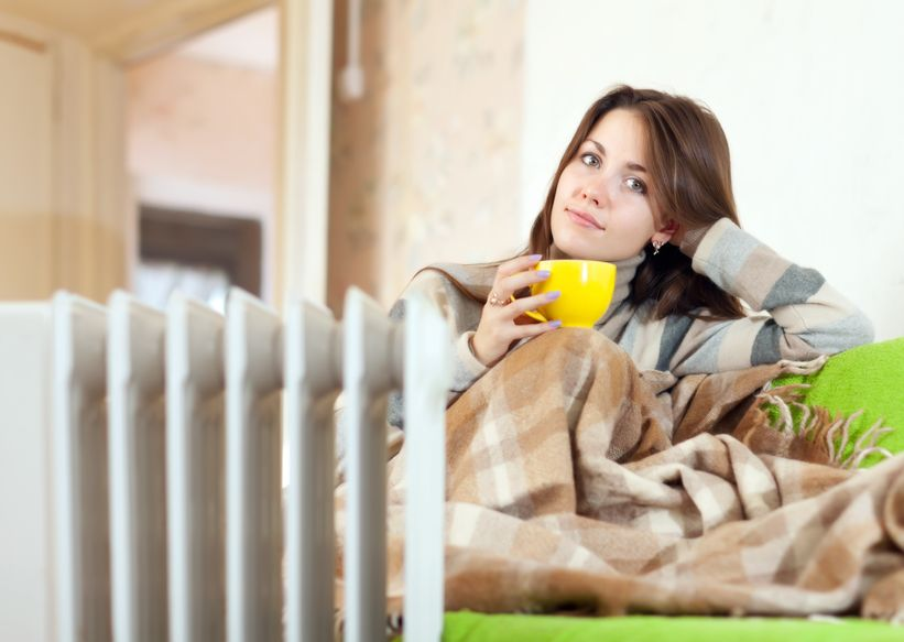 Woman comfortable next to a furnace