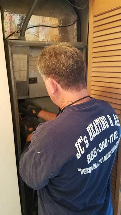 Jason Charkosky doing a heat and air repair