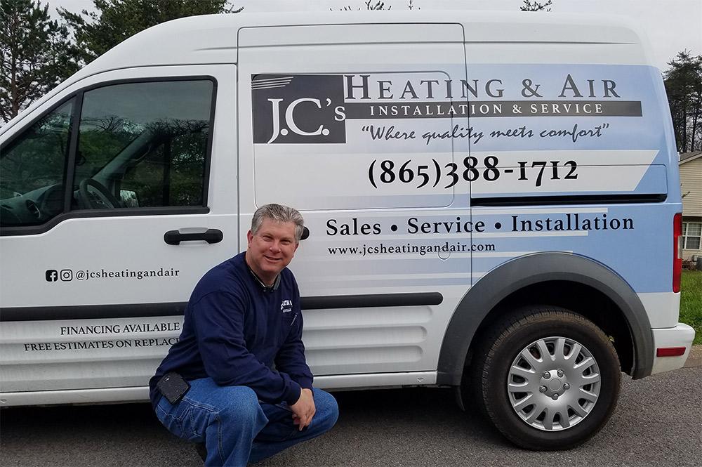 Jason Charkosky standing next to his new HVAC van