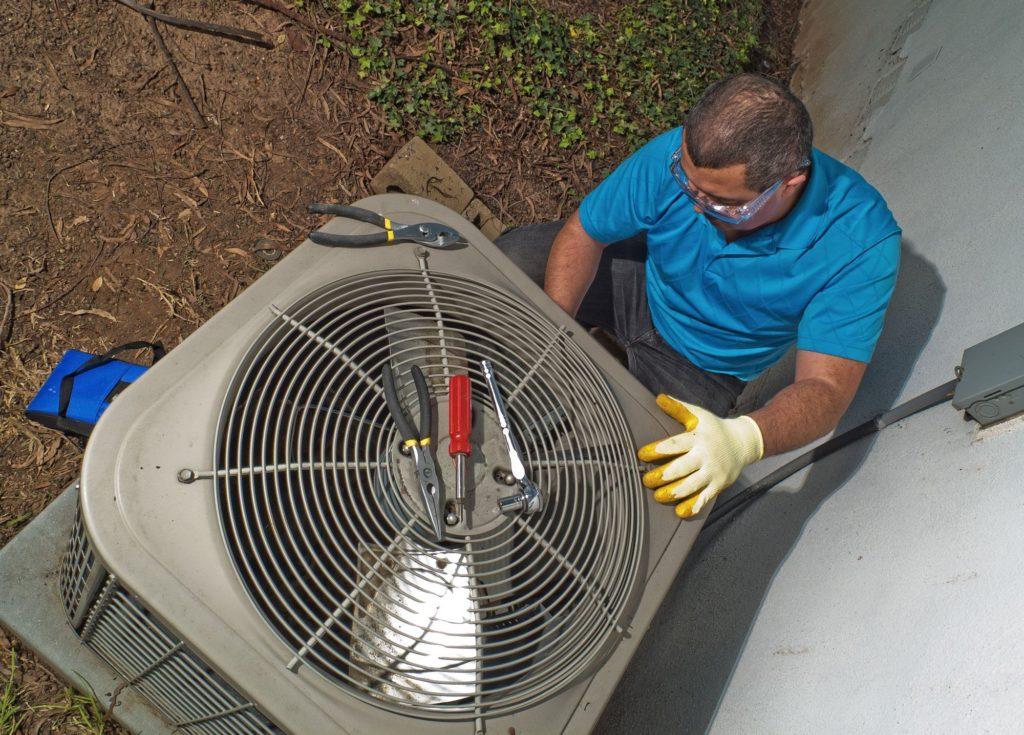 Man Repairing air conditioner HVAC