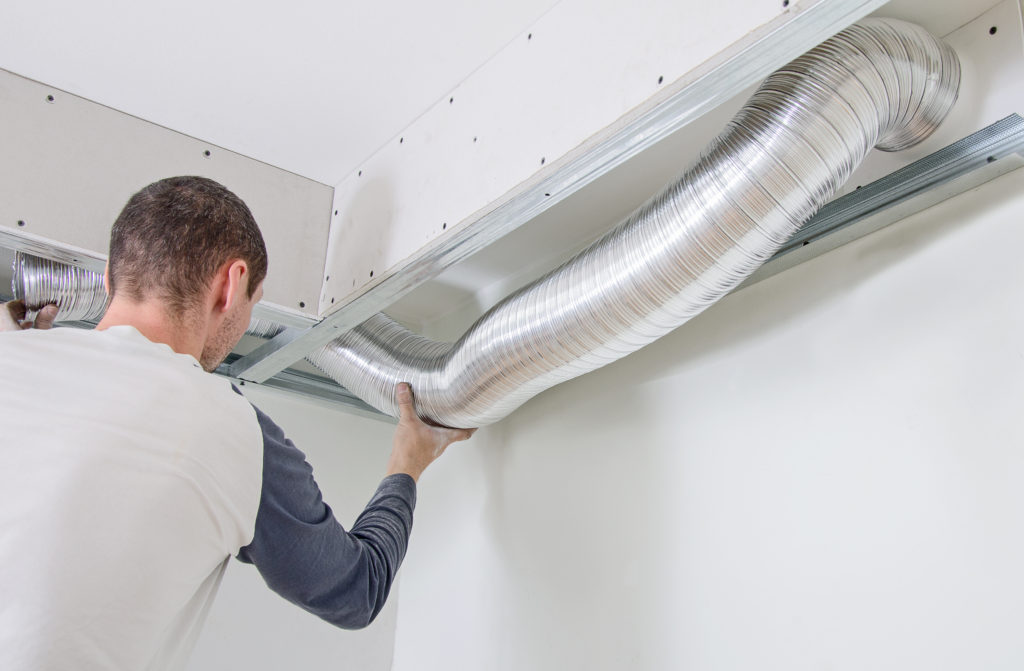 Man Working On Ductless HVAC System