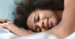 teen on pillow asleep