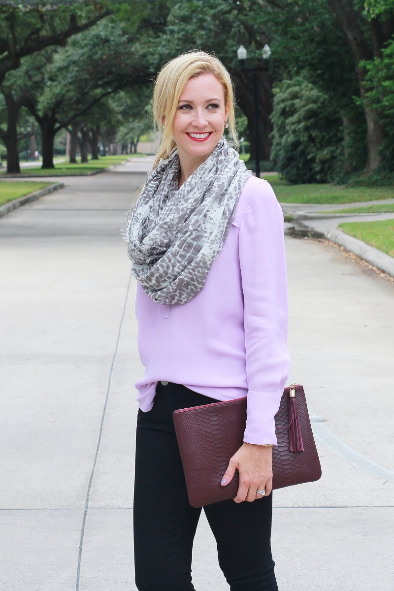 Purple shirt with black jeans and merlot accessories
