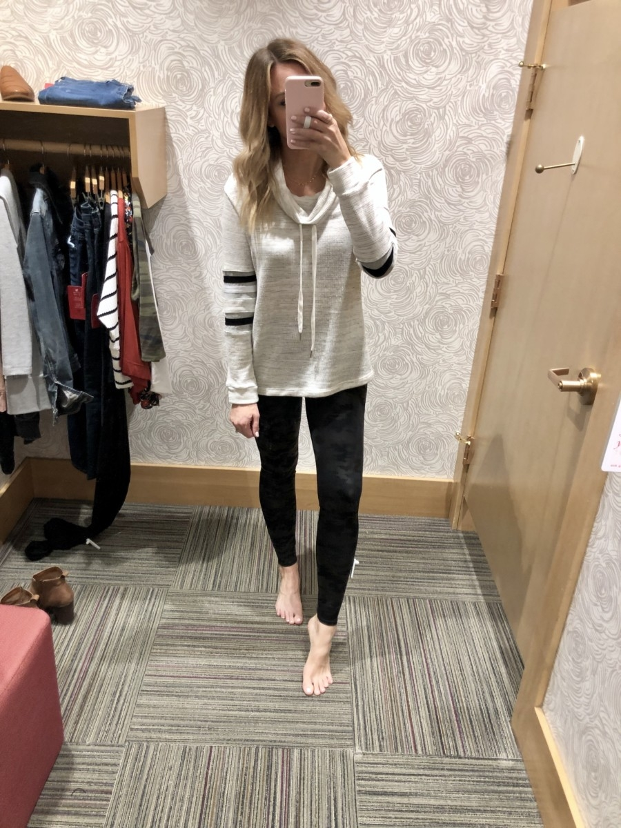 Evereve Sale featured by top US life and style blog Haute & Humid; Image of woman wearing Evereve camo leggings, Evereve cardigan and Evereve white tee.