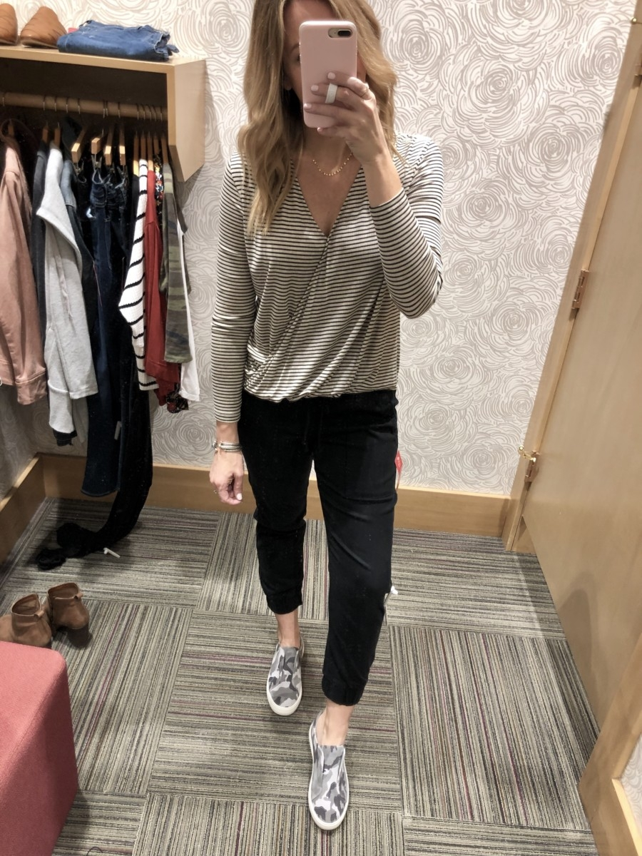 Evereve Sale featured by top US life and style blog Haute & Humid; Image of woman wearing Evereve joggers, Evereve striped shirt and Evereve camo shoes.