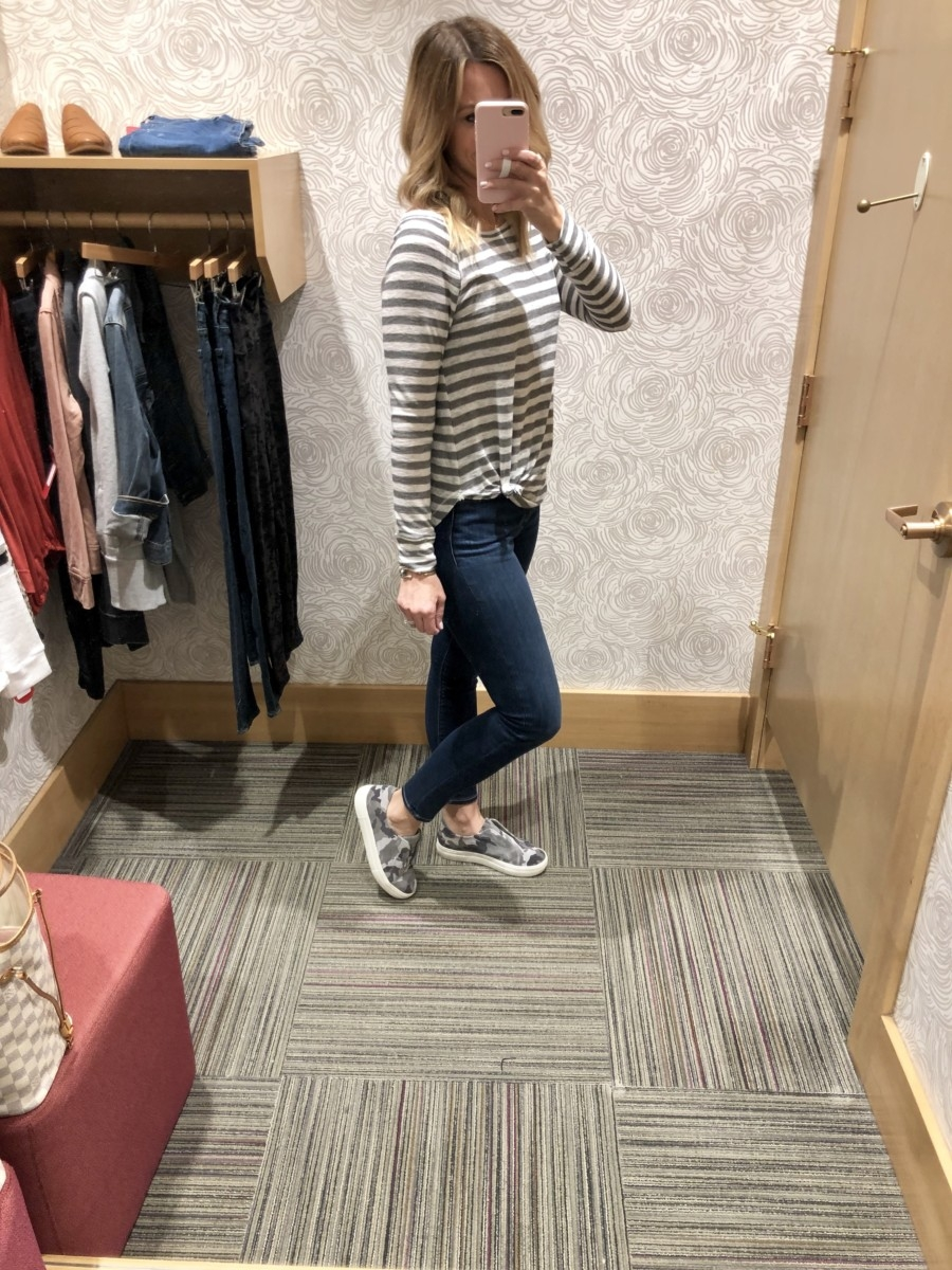 Evereve Sale featured by top US life and style blog Haute & Humid; Image of woman wearing AG jeans, Evereve striped shirt and Evereve camo shoes.