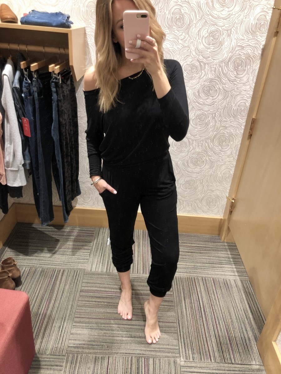Evereve Sale featured by top US life and style blog Haute & Humid; Image of woman wearing Evereve black jumpsuit.