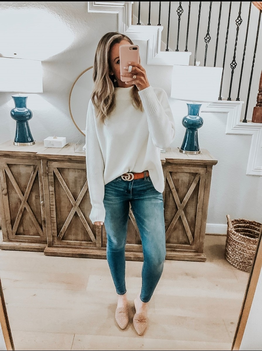Amazon Favorites featured by top US fashion blog Haute & Humid; Image of a woman wearing Amazon sweater, dupe Gucci belt, Steve Madden sliders and American Eagle jeans.