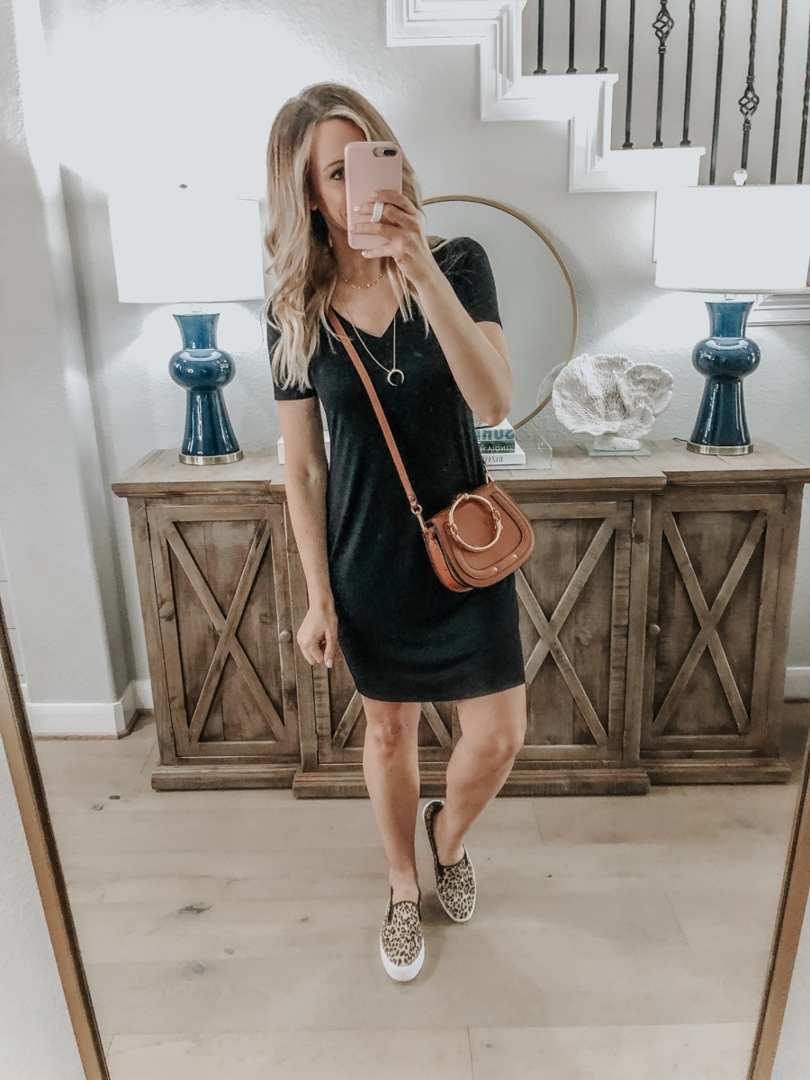 Amazon Favorites featured by top US fashion blog Haute & Humid; Image of a woman wearing Amazon Black Jersey Dress, Crescent Necklace- Gold layered necklaces and leopard sneakers.