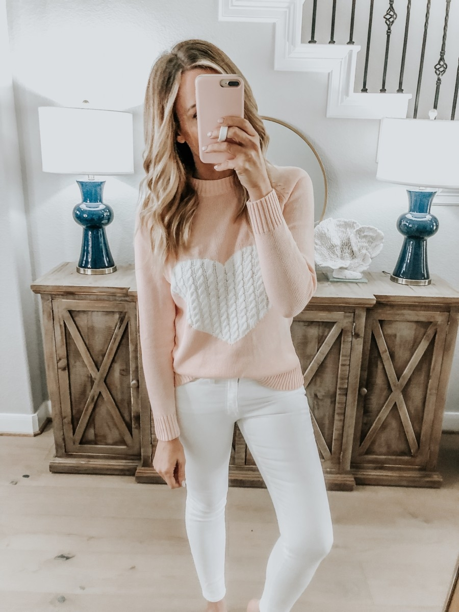 Amazon Favorites featured by top US fashion blog Haute & Humid; Image of a woman wearing a heart sweater from Amazon and Nordstrom white jeans.