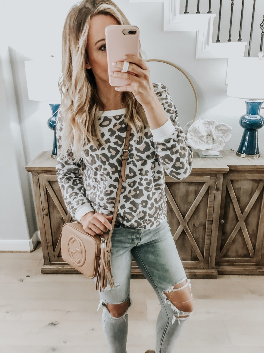 Amazon Favorites featured by top US fashion blog Haute & Humid; Image of a woman wearing Amazon leopard sweatshirt and Madewell jeans.