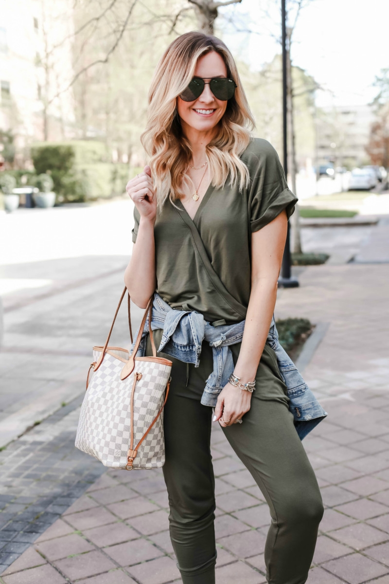 Spring Jumpsuit featured by top US fashion blog Haute & Humid; Image of a woman wearing Evereve jumpsuit, ABLE denim jacket and Treasure & Bond wedge sandals.