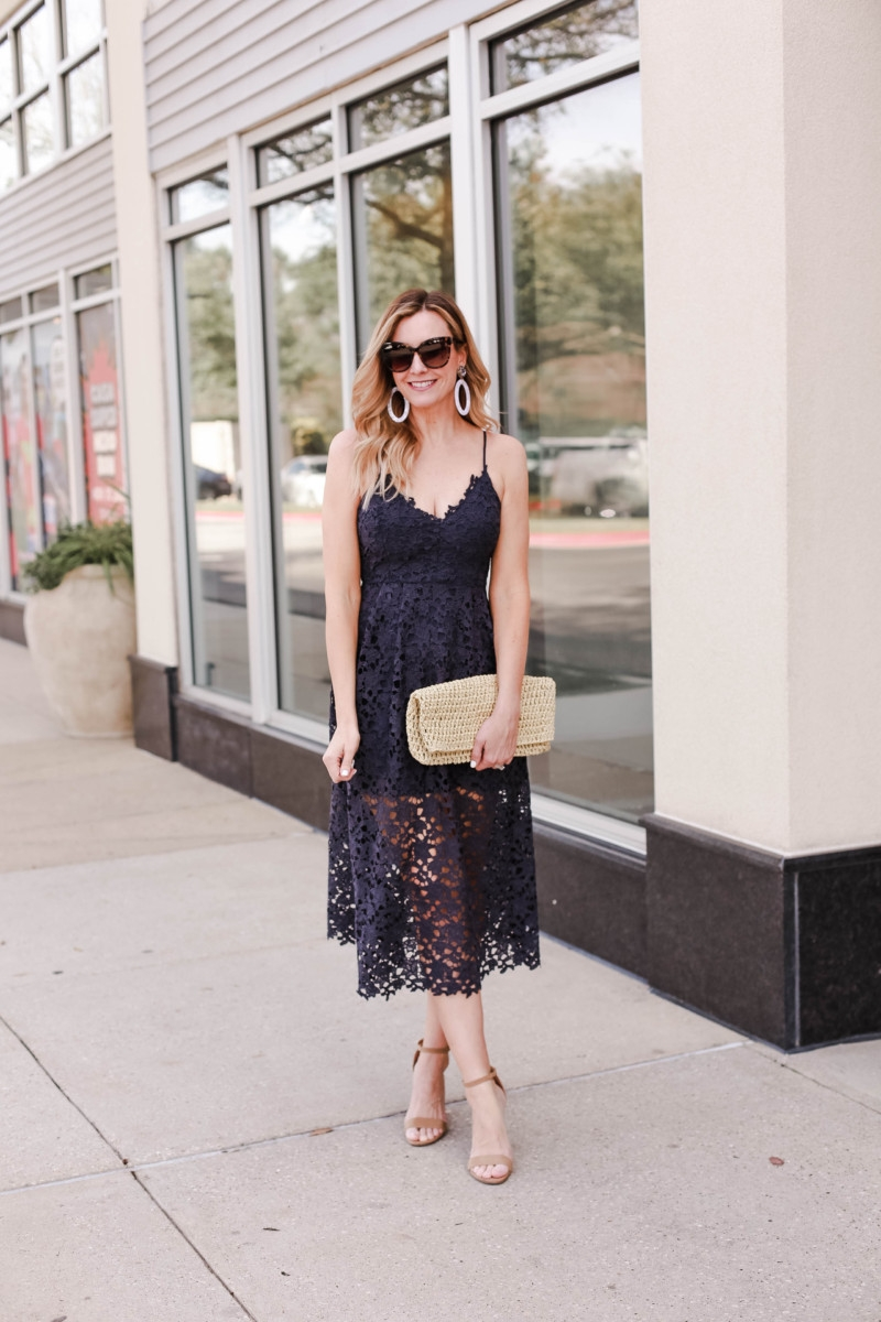 Spring Beauty featured by top US life and style blog Haute & Humid; Image of a woman wearing Nordstrom dress, Steve Madden sandals, Amazon clutch, Bauble Bar earrings and LE Specs sunglasses.