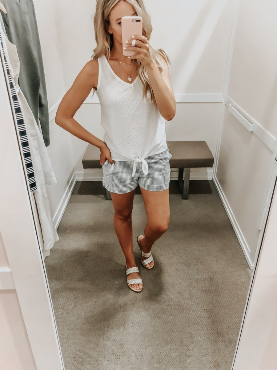 Best Memorial Day Weekend Sales featured by top US fashion blog Haute & Humid; Image of a woman wearing LOFT white tank top and LOFT striped shorts.