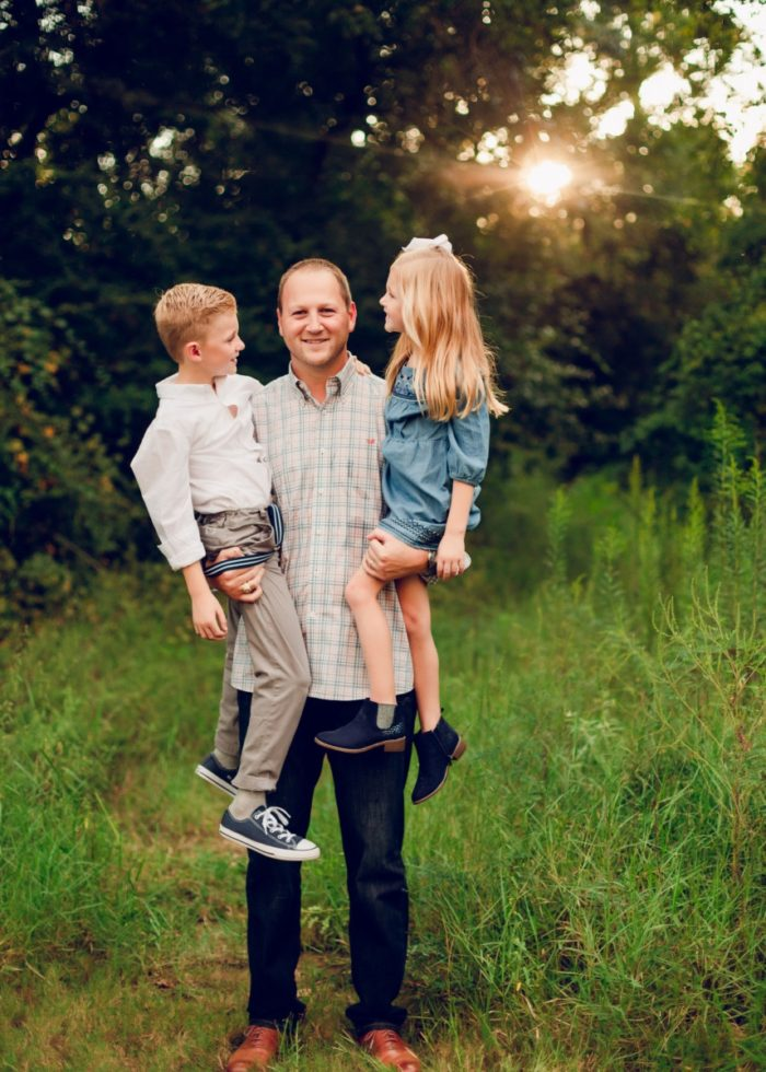 haute and humid blog | popular Houston lifestyle blog | father's day gift ideas | Father's Day gift guide featured by top Houston lifestyle blog, haute and humid: image of man holding two young kids outside in a field