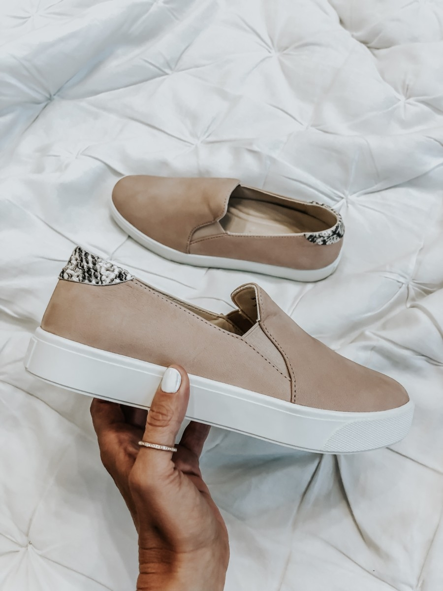 cole haan sneakers | Nordstrom Anniversary Sale Favorites by popular Houston fashion blog, Haute and Humid: image of woman holding COLE HAAN SLIP ON SNEAKERS