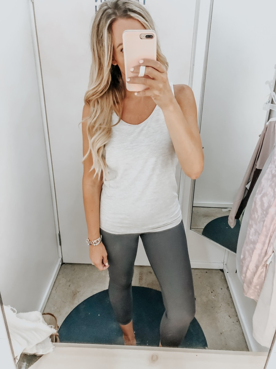 workout leggings | Old Navy Try On - August 2019 by popular Florida fashion blog, Haute and Humid: image of a woman standing in a Old Navy dressing room and wearing an Old Navy Breathe ON Mesh-Back Tank and Old Navy High-Waisted Elevate Built-In Sculpt 7/8-Length Compression Leggings.