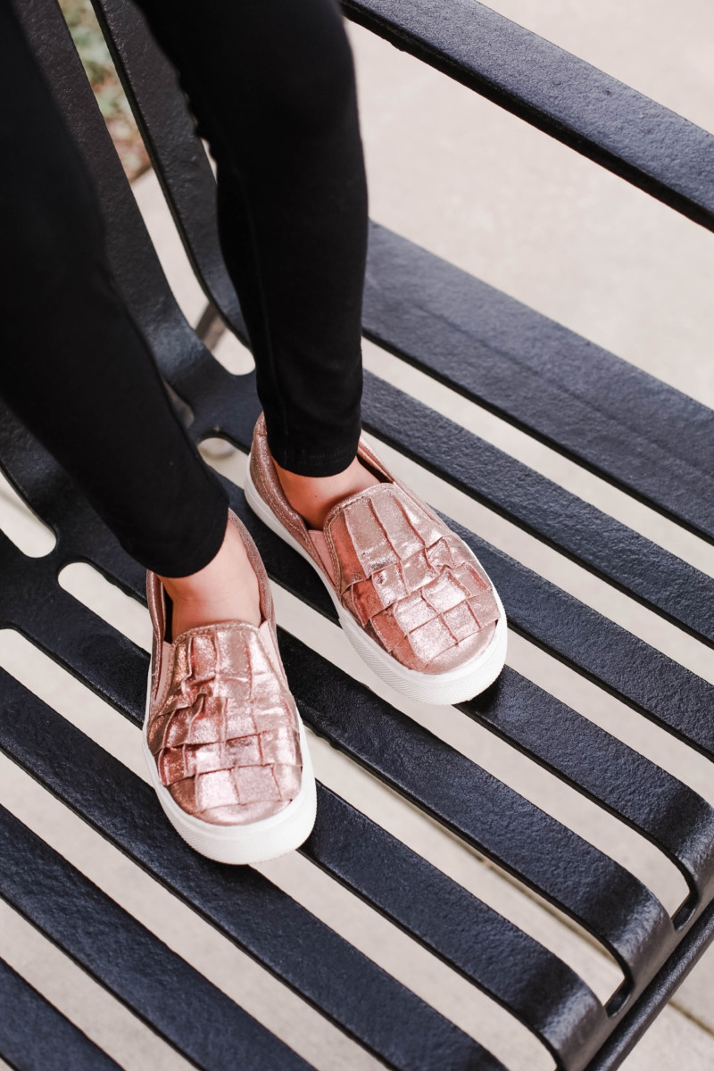 girls slip on sneakers | fall girls clothing | Girls Animal Print fall Clothes | Walmart Fall Clothing: Girls Animal Print Favorites by popular Houston fashion blog, Haute and Humid: image of a girl wearing metallic rose gold ruffle sneakers and black leggings.