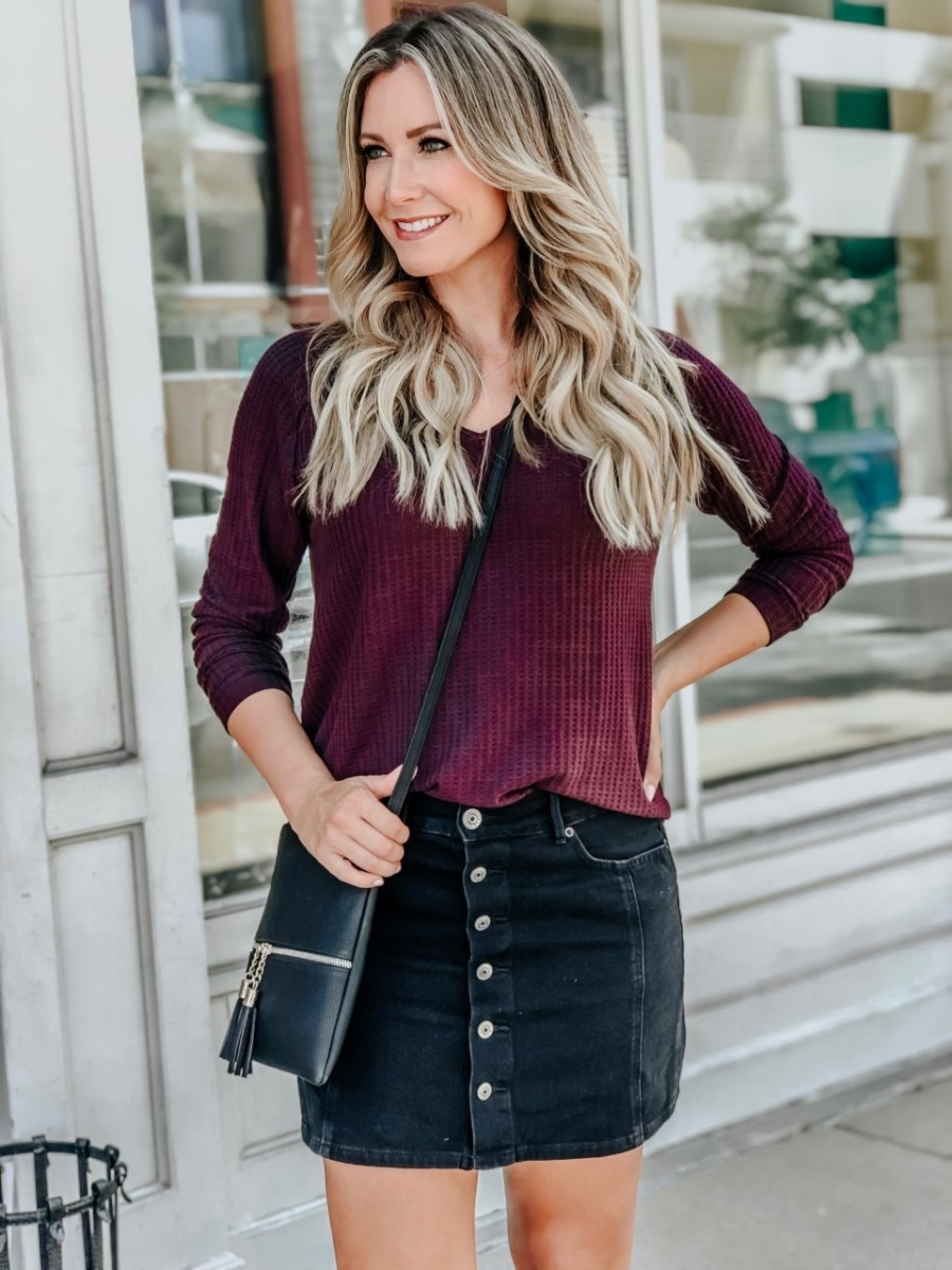 aggie game day outfits | College Game Day Outfits by popular Texas fashion blog, Haute and Humid: image of a woman standing outside and wearing a AE PLUSH WAFFLE LONG SWEATSHIRT, AE HIGH-WAISTED A-LINE SKIRT, Nordstrom Vince Camuto Gigietta Bootie, and Amazon DELUXITY Lightweight Medium Crossbody Bag with Tassel.
