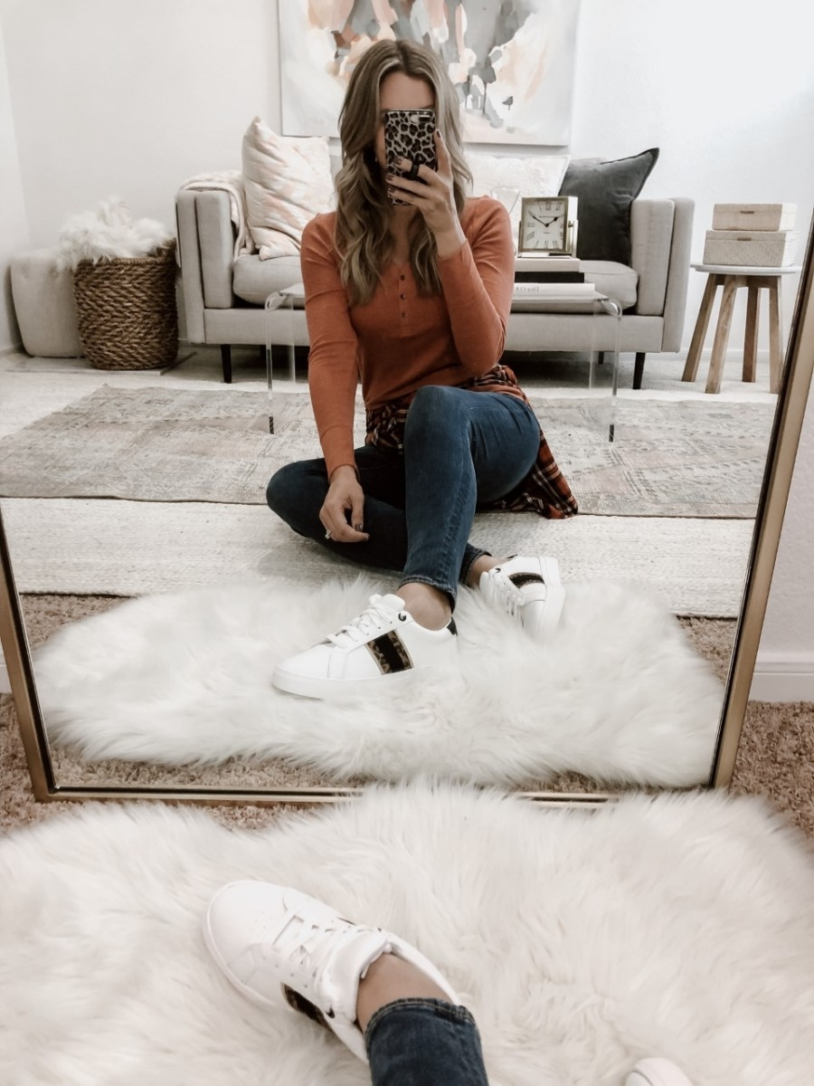 womens fashion sneakers | Must Have Affordable Fall Flats by popular Houston fashion blog, Haute and Humid: image of a woman wearing a Walmart Time and Tru Women's Thermal Henley T-Shirt, Walmart Time and Tru Womens Time and Tru Fashion Sneaker, and Walmart Time and Tru plaid shirt.