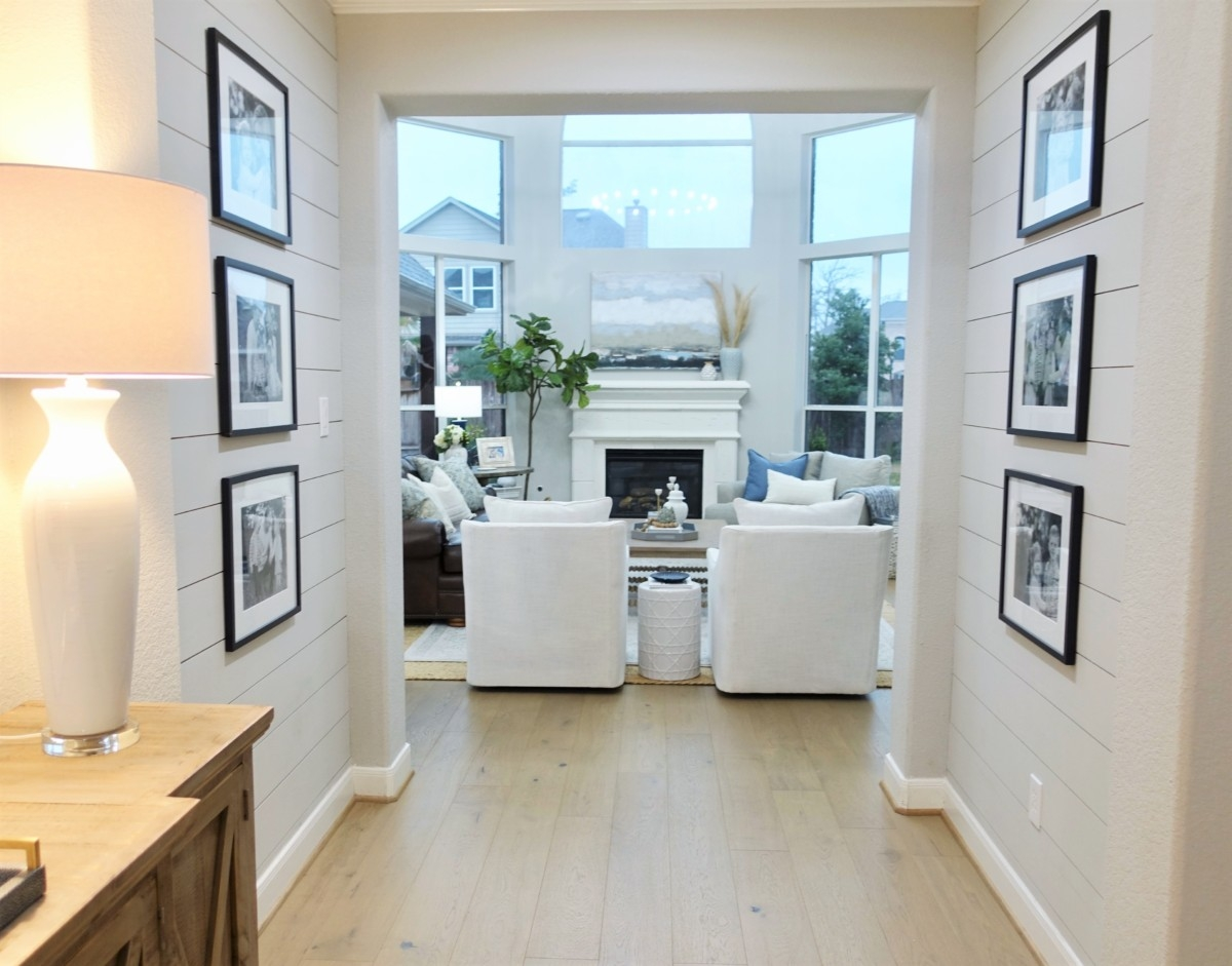 shiplap | Living Room Makeover by popular Houston lifestyle blog, Haute and Humid: image of a remodeled living room with a Wayfair Shayla 20-Light Candle Style Wagon Wheel Chandelier, Wisteria Barley Twist Coffee Table, and Perigold ARIANA VERNAY RECTANGULAR CONSOLE TABLE.