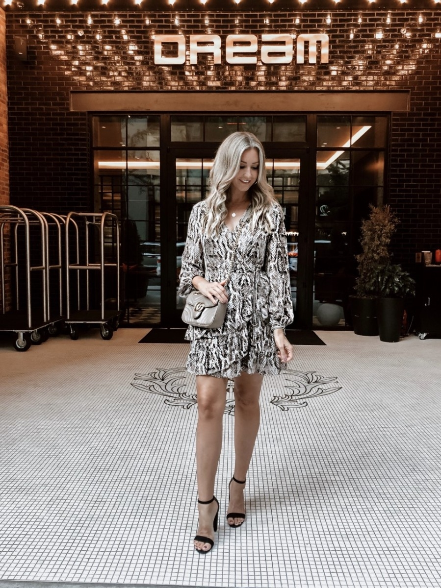 snake print dress | January Best Sellers by popular Houston life and style blog, Haute and Humid: image of a woman wearing a Nordstrom Sultry Snake Ruffled Long Sleeve Wrap Front Dress 1.STATE.