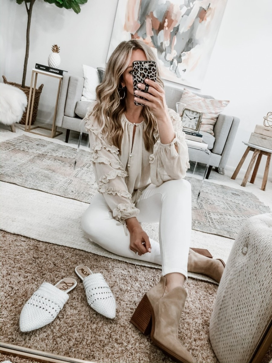 spring top | January Best Sellers by popular Houston life and style blog, Haute and Humid: image of a woman wearing a Gigietta Bootie VINCE CAMUTO, Nordstrom Ruffle Peasant Top TOPSHOP, Nordstrom Madewell 9-Inch High Waist Skinny Jeans, and Zappos Sam Edelman Natalya.