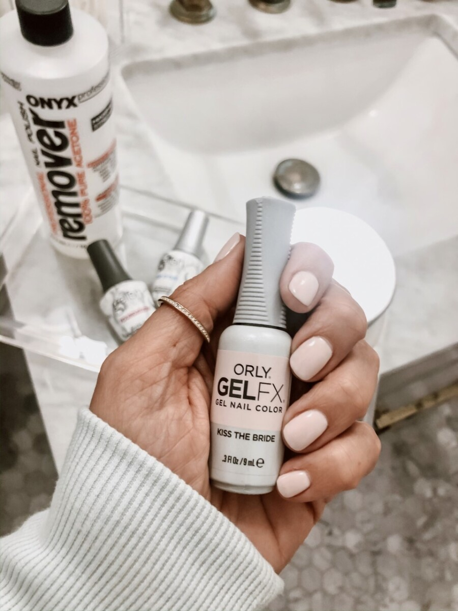 at home gel manicure | At Home Gel Manicure by popular Houston beauty blog, Haute and Humid: image of a woman holding a bottle of Orly Gel FX.