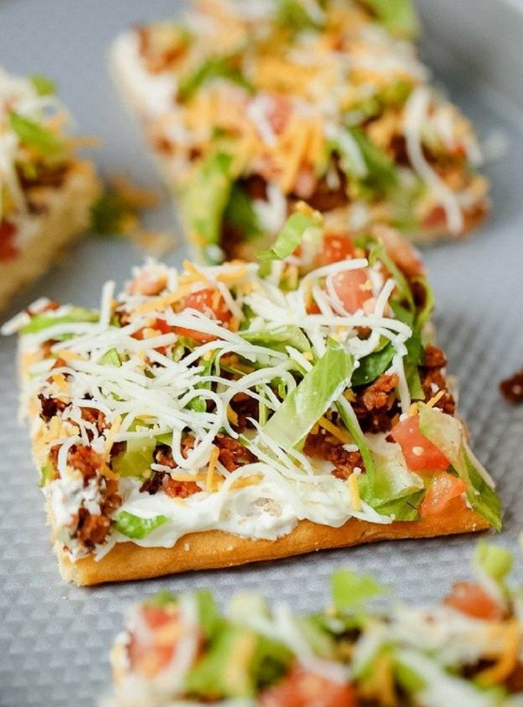 Stuck at Home Recipes by popular Houston lifestyle blog, Haute and Humid: image of taco pizza.