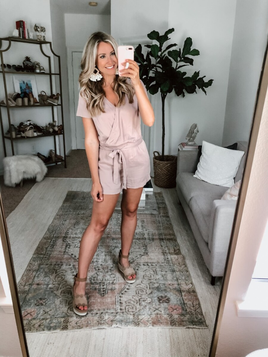 pink romper | Amazon Spring Try On by popular Houston fashion blog, Cute and Little: image of a woman wearing a Amazon Daily Ritual Women's Tencel Short-Sleeve Wrap Romper, Amazon WFYOU Rattan Tassel Earrings, and DSW DUNJA WEDGE SANDAL.