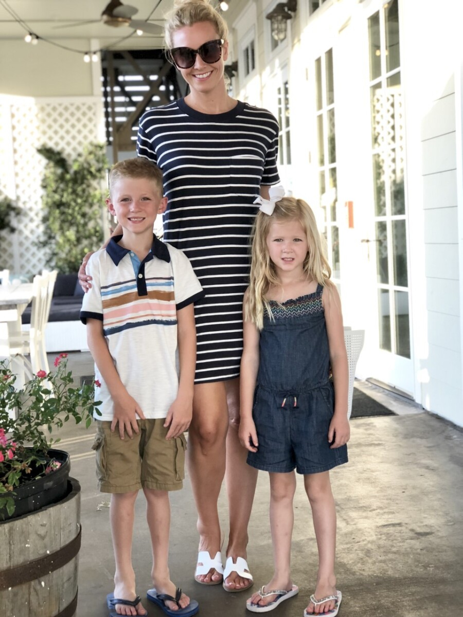 galveston restaurants | Galveston Travel Guide by popular Houston travel blog, Haute and Humid: image of a mom and her two kids standing outside of a restaurant in Galveston, Texas.