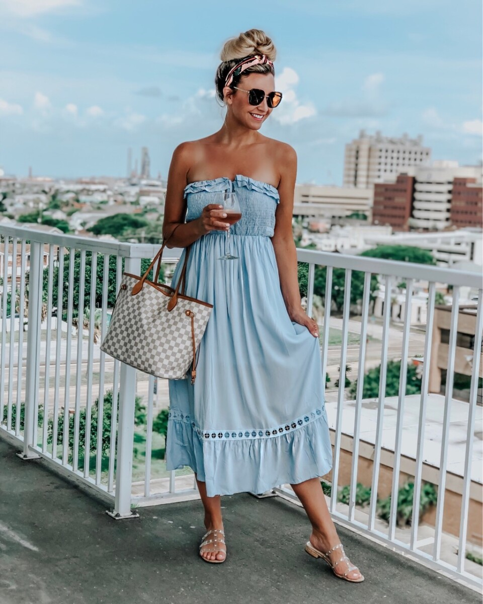 beach outfit | Galveston Travel Guide by popular Houston travel blog, Haute and Humid: image of a woman wearing a Amazon BOCOTUBE Women's Summer Sleeveless Strapless Ruffle Off The Shoulder Swing Cocktail Party Dress and Amazon Jessica Simpson Women's Caira2 Flat Sandal.