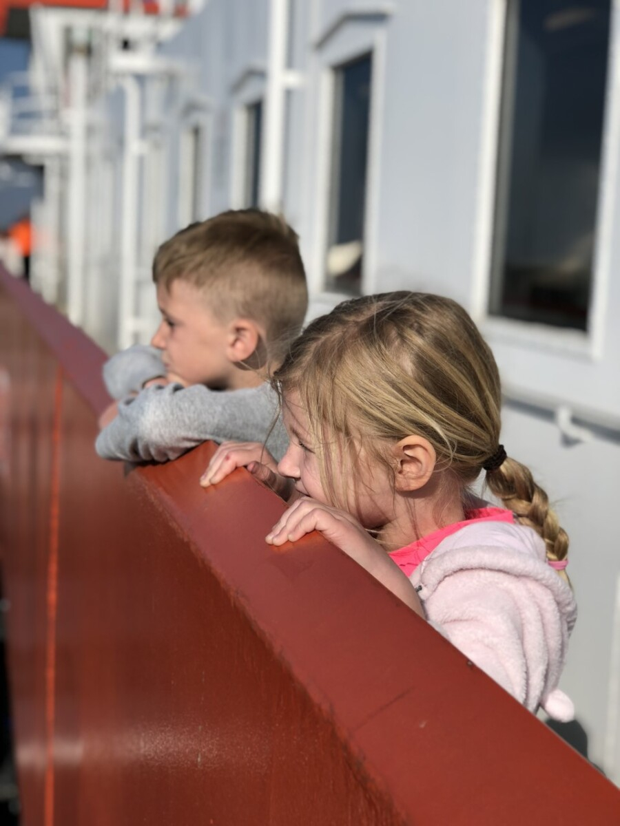 galveston ferry | Galveston Travel Guide by popular Houston travel blog, Haute and Humid: image of two kids riding on the Galveston ferry.
