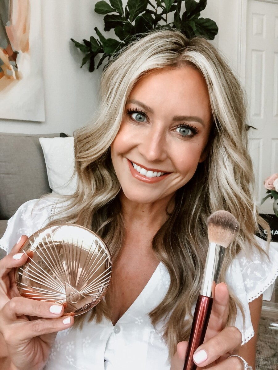 charlotte tilbury bronzer | Sweat Proof Makeup by popular Houston beauty blog, Haute and Humid: image of a woman holding a CHARLOTTE TILBURY Bronzing Powder and makeup brush.